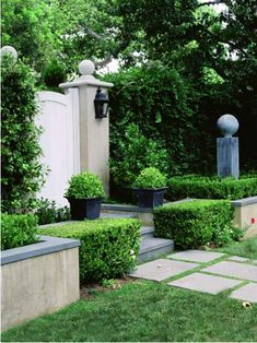 boxwoods, pathway, and garden gate.