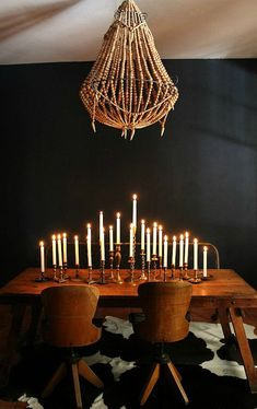 centerpiece: 20+ mismatched brass candlesticks with tapers
