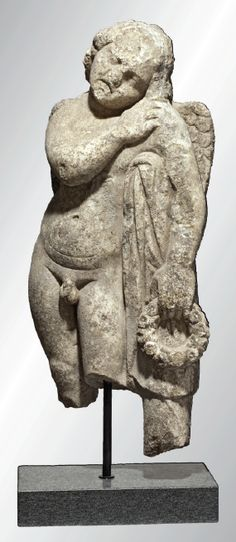 """A Roman Hymenaeus, marble sculpture, 36"""" high, end of 2nd century AD."""