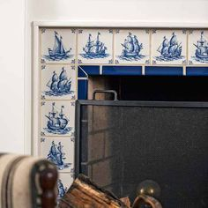 Classic Dutch Delft tiles were used to create a traditional fireplace surround.
