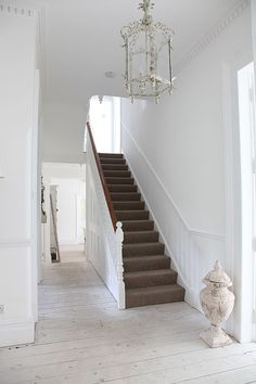 Entry lights, entry hallway, light fixtures, white walls, white decor, entrance halls, entryway, hallway stairs, painted floors