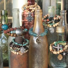 Old bottles for bracelet display.  I love the worn, tarnished, rusty, discolored look of it, but would need something unbreakable.