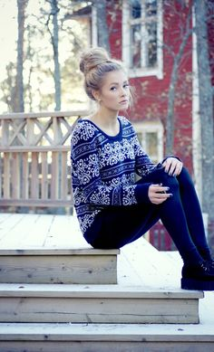 patterned sweater and bun