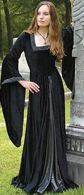 Museum Replicas black countess velvet long dress with square neckline, long sleeves, beaded trim, contrast front pleat panel