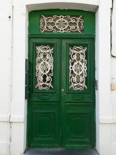 Green and White Door, Northern France%~