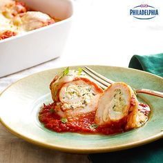 These dinner-time Mozzarella-Stuffed Chicken Breasts are filled with Philadelphia Cream Cheese, oregano, mozzarella and green peppers. The cheesy herb filling complements the pasta sauce perfectly, leaving you with a hearty meal that won't disappoint.