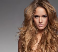 Long Blonde Hairstyle with Curls and Volume