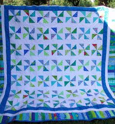 Turquoise, Blue, and Green Pinwheel Quilt. $300.00, via Etsy.