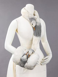 c. 1880-99    The Met says: A rare example made from the heads and feathers of gulls, this accessory set represents the passion for using bird feathers and bird parts to decorate hats and other high-style fashion accessories in the 19th century. The practice ended in the early 20th century as birds were becoming extinct in order to supply the fashion industry.