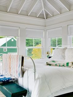 Simple bedroom, cottage,country,  guest room, antique metal bed frame, white, plank ceilings, vaulted, green worn bench, farm