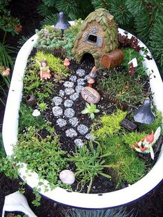"""All I need is an odl tub! And BAM! A little place for the kids to have their own garden space.  And use old barbie furniture so they can make a""""fairy garden"""""""