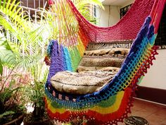 Rainbow Colors Sitting Hammock, Hanging Chair Natural Cotton and Wood plus Simple Fringe. $41.00, via Etsy.