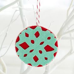 Download this snowflake pattern for a fun felt ornament: http://www.bhg.com/christmas/ornaments/easy-felt-christmas-ornaments/?socsrc=bhgpin120213snowflakedesignornament&page=1