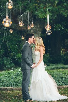 beautiful bride & groom portrait with hanging votives
