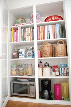 cook books in the cabinet, why didn't I think of that