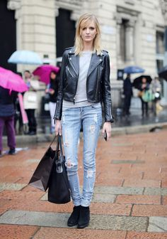Model Daria Strokous in a leather jacket and distressed jeans