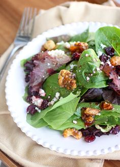 Candied Walnuts  and Gorgonzola Salad  -Ingredients:        1/2 cup walnut halves      1/4 cup white sugar      3 cups mixed greens      1/2 cup Gorgonzola cheese      1/2 cup dried cranberries        2 tablespoons store bought raspberry vinaigrette      1 tablespoon white wine vinegar      1 tablespoon olive oil      (optional) sliced red onion