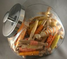 Wrap ribbon on round clothes pins, store in a candy jar.