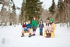 family photo in winter with adirondack chairs