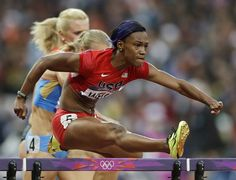 United States' Kellie Wells competes in a women's 100-meter hurdles semifinal during the athletics in the Olympic Stadium.