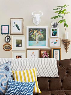 Such a fun gallery wall. Love the variety. More Decorating Updates for Less: http://www.bhg.com/decorating/budget-decorating/cheap/cheap-decorating-ideas/