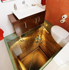 transparent floor in bathroom-oh gosh im never ever gona do wat i have to do if this is my bathroom floor! lol