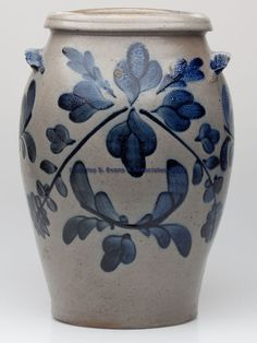 OUTSTANDING STRASBURG, VIRGINIA DECORATED STONEWARE JAR, salt glazed, approximately 4 gallon capacity, elongated ovoid form with an angled-collar rim and slightly arched tab handles. Exuberant brushed bright cobalt decoration comprising tripartite leaves, flowers, vines and plumes full round, additional cobalt on top of handles. Attributed to the shop of John and James Miller, Strasburg, VA. Circa 1830-1840
