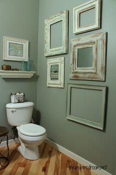 small bathroom makeover blue green walls. I really like the frames on the wall! It doesn't make the bathroom TOO girly
