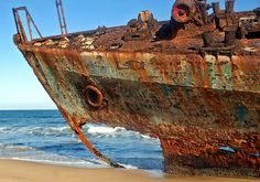 rusty hull of a stranded and abandoned ship