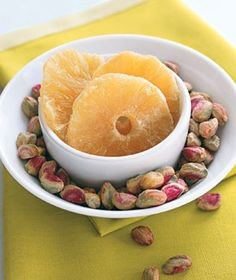 Find 9 healthy snacks to tide you over until dinners ready.