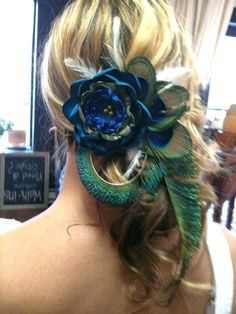 hair and peacock feathers