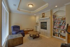 Master with en-suite, huge walk in closet and cozy sitting room with fireplace.