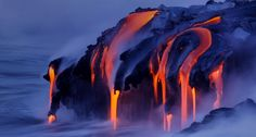 Viscous lava from Kilauea continues to pour into the ocean at Kalapana, Hawaii -- Bruce Omori/Corbis
