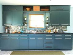 Teal cabinets, black counters, horizontal hardware