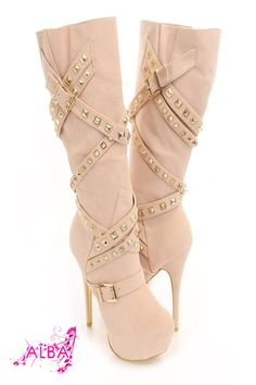 You will be head over heels for these saucy little numbers! They will perfectly compliment any outfit for any occasion! Make sure to add these to your collection, they definitely are a must have! The features for these boots include a faux suede upper with a wrap around strappy design with pyramid studded detailing, buckle accents, stitched detailing, almond shaped closed toe, gold bottom soles, full inner side zipper closure, smooth lining, and cushioned footbed. Approximately 6 inch heels, 2 …