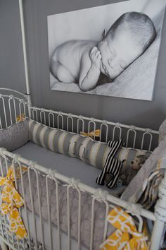 ADORABLE! I love everything about this!!!   Black & white prints look great in a gray nursery!  #gray #nursery #monogramcribbedding #black