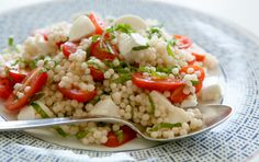 Transform the traditional mozzarella and tomato appetizer into a meal-worthy salad with the addition of pearl couscous. White balsamic vinegar and fresh basil keep things lively.