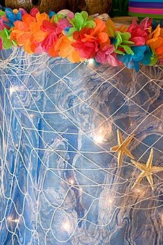 Cruise door decorations on pinterest tropical fish for Fish net decoration ideas