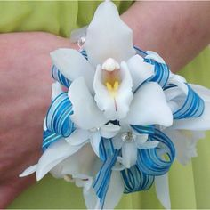 Prom corsage I created at buds 'n bloom with white cymbidium orchids . Order your next corsage with us. www.budsnbloomdesignstudio.com