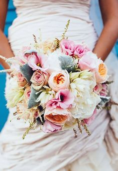 The bride's bouquet is a stunner from Butterfly Floral that included pastel peonies, dahlias and roses. Callaway Gable.