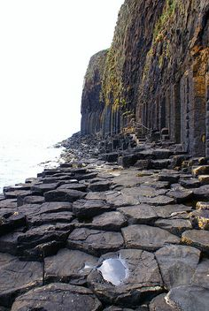 The way along the cliff to Fingal's Cave on the uninhabited Isle of Staffa, Inner Hebrides, Scotland.  Similar formations are found at the Giant's Causeway in Ireland. According to the legend, the Irish giant Fionn mac Cumhaill (Fingal) built the causeway to walk from Ireland to Scotland to fight his Scottish counterpart Benandonner.