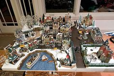 """Really like the original pinners ideas here! Especially how he formed his """"harbor"""", plus the use of the sisal hedges. Terrific. christma villag, villag idea, christmas village ideas, christmas villages, holiday decor, xmas villag"""