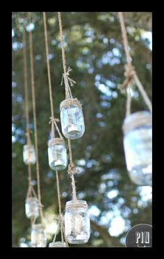 Rustic Wedding: I have tons of mason jars, just need twine, use battery operated tea lights and hang from trees