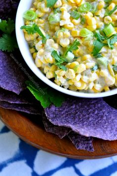 This sweet and spicy corn salsa is the perfect side at your next BBQ! Creamy, sweet, and a bit of heat-- it's perfect with anything you pair it with! #recipe #summer #corn #salsa