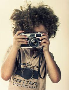 kid and a camera