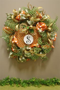 windowpane and burlap ribbon are perfect for this personalized fall wreath