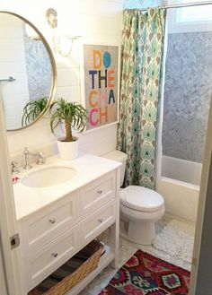 love this bathroom ( check out the shower tile.  oh, and the ikat ! )
