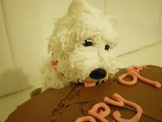 My first or second favorite. This cake Westie looks SO realistic licking icing at the edge of the cake!