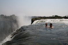 Devil's Pool at Victoria Falls (or Mosi-oa-Tunya). In the fall, when the river is at its lowest and slowest, a natural rock retaining wall allows swimmers to safely jump into the pool, float to the edge, and look over the falls without being swept down. #zambia