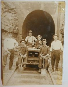 VINTAGE REAL PHOTO POSTCARD WEST VIRGINIA COAL MINE MINERS~Great photo of WV coal miners in front of the entrance to the mine.  I do not know which mine this was. Wonderful item for collectors of coal mining items.  Maker:  Unknown  SIZE:   4.75 inches across x 3.5 inches high  Condition:  There are some issues with this card.  It has been written on the back with pencil.  It has been cut, likely to fit into a photo album as there is tape residual on the card.